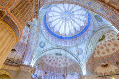 Mosque dome interior with blue ornaments Stock Photos