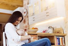 Mother breastfeeding her baby Royalty Free Stock Photography