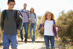 Mother And Children Hiking In Countryside Royalty Free Stock Image