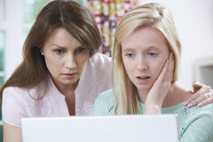Mother Comforting Daughter Victimized By Online Bullying Stock Images