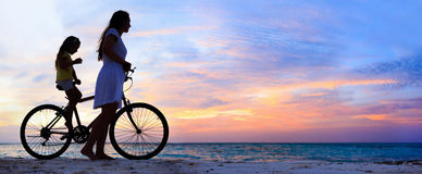 Mother and daughter on a bike Stock Photography