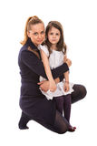 Mother embracing her daughter Stock Photos