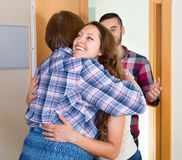 Mother greeting happy young couple Royalty Free Stock Image