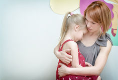 Mother hugging her child. Stock Photos