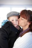 Mother kissing cute toddler Stock Photo