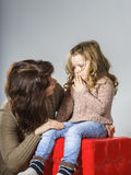Mother reassuring little daughter Stock Photography