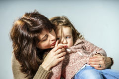 Mother reassuring little daughter Royalty Free Stock Images