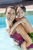 Mother With Son On Her Shoulders In Swimming Pool Stock Photography