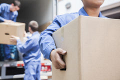 Movers unloading a moving van Royalty Free Stock Photo
