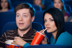 This movie is so exciting! Stock Photography