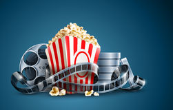 Movie film reel and popcorn Royalty Free Stock Photos