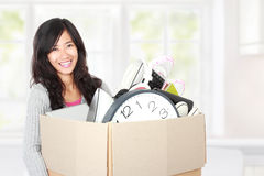 Moving day. woman with her stuff inside the cardboard box Stock Photography