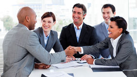 Multi-ethnic business people greeting each other Stock Image