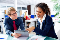 Multi ethnic business people teamwork touch pad Stock Image