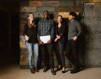 Multi ethnic business team looking happy together Royalty Free Stock Photography