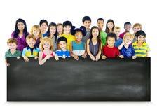 Multi-Ethnic Children Holding Empty Blackboard Concept Royalty Free Stock Photos