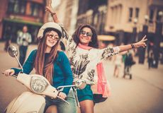 Multi ethnic girls on a scooter Stock Images