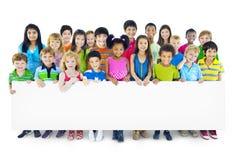 Multi-Ethnic Group of Children Holding Empty Billboard Royalty Free Stock Photo