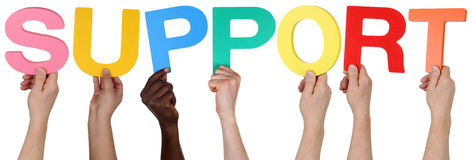 Multi ethnic group of people holding the word support Royalty Free Stock Image