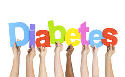 Multi-Ethnic Hands Holding The Word Diabetes Stock Photography