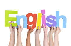 Multi-Ethnic Hands Holding The Word English Stock Photos