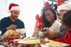 Multi Generation Family Enjoying Christmas Meal At Home Royalty Free Stock Photo