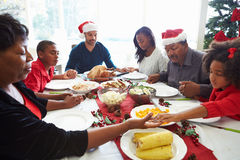 Multi Generation Family Praying Before Christmas Meal Royalty Free Stock Images