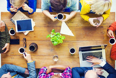 Multiethnic People with Start up Business Talking in a Cafe Royalty Free Stock Photography