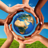 Multiracial Hands Together Around World Globe Royalty Free Stock Image