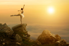 Mystic pictures, ballet dancer stands on the cliff edge Stock Photo