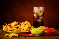 Nachos plate, dip and cola drink Royalty Free Stock Photos