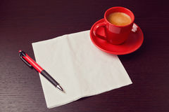 Napkin and coffee cup on desk. Mock up for sketch presentation Royalty Free Stock Photography
