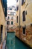 Narrow Venetian canal - Venice, Italy Royalty Free Stock Photography