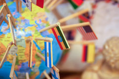 National flags stuck in the globe Royalty Free Stock Photography