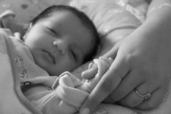 New bond of Baby and mother; bonding and holding for first time Stock Images