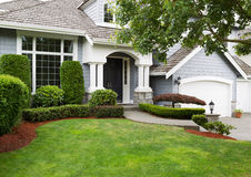 Newly painted and stained exterior of modern home during summert Royalty Free Stock Image