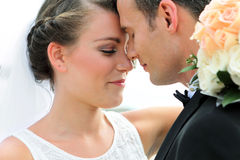 A newlywed couple look happy Royalty Free Stock Images