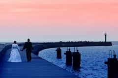 Newlyweds sea sunset walk Stock Photo