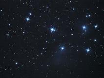 Night sky stars Pleiades open cluster (M45) in Taurus constellation Stock Photo