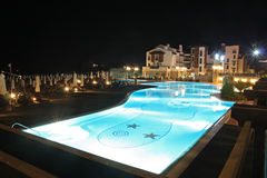 Night swimming pool. Hotel. Royalty Free Stock Images