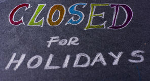Note for closed on holidays Stock Photography