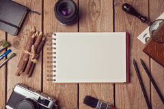 Notebook mock up for artwork or logo design presentation with film camera and lens. View from above Royalty Free Stock Image