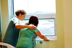 Nurse reassuring Mom in labor Royalty Free Stock Photos