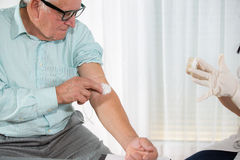 Nurse with syringe is taking blood for test at the doctor office Stock Photography