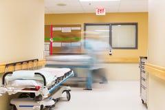 Nurses With Stretcher Walking In Hospital Corridor Stock Photos
