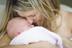 Nurturing Mother Holding Her Precious Newborn Baby Girl Royalty Free Stock Image