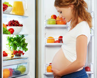 Nutrition and diet during pregnancy. Pregnant woman with fruits Stock Images