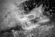 Off road vehicle crossing river Stock Image