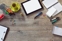 Office desk background with tablet, smart phone and cup of coffee. View from above with copy space Royalty Free Stock Photography