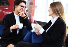 Office workers on coffee break, woman enjoying chatting Stock Photos